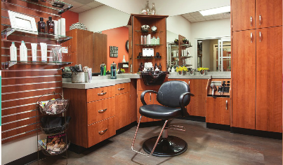 Sola salon suite with wood faced cabinetry, two large mirrors and stylish decor