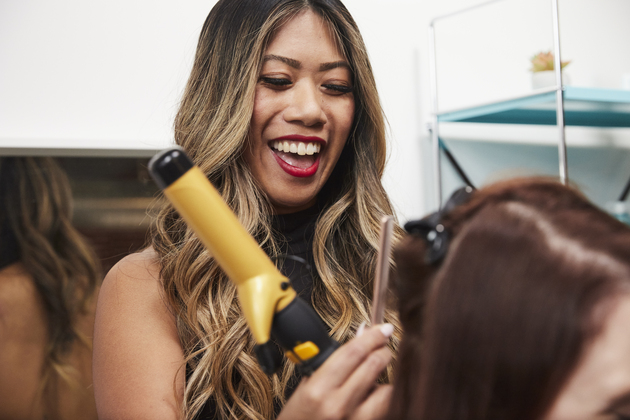 Happy stylist works on client