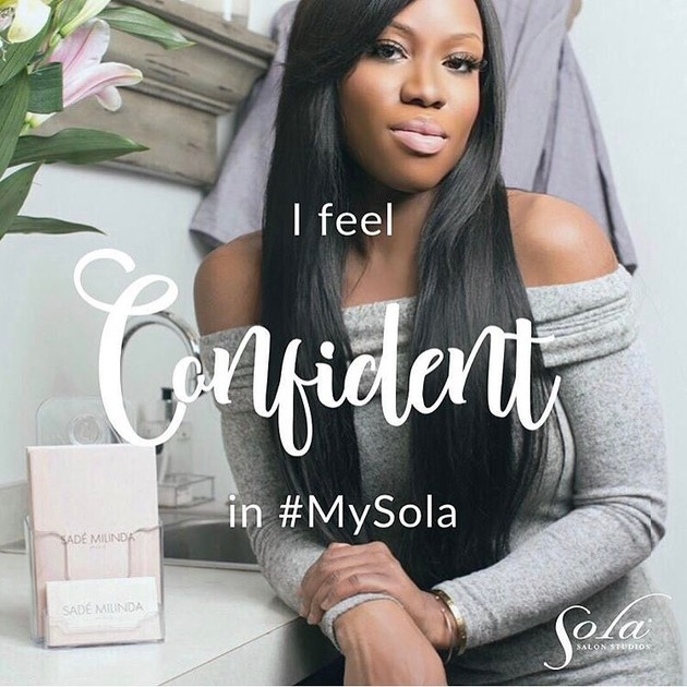 "Salon owner posing with words ""I feel Confident in #MySola"" overlapping"