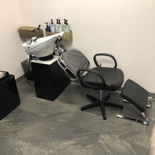 Each salon studio and salon suite for hair stylists include a freestanding stand behind luxurious white porcelain shampoo bowl and separate styling station with Upscale modern cabinets and fixtures with white granite countertops, individual AC controls, and adjustable LED lighting.