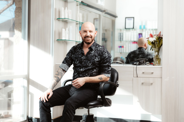 Two stylists smile in their Sola salon studio