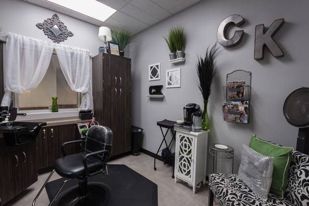 Customized single suite decorated in a chic black and white style with splashes of greenery