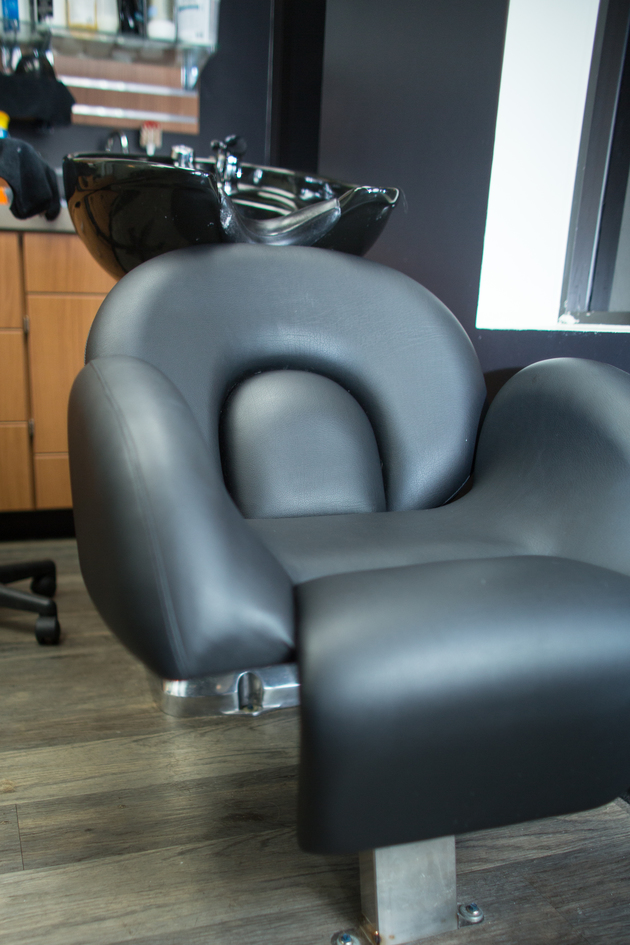 Garfield chair in front of the shampoo bowl in studio at Sola Salon Studios hair salon in Longview.
