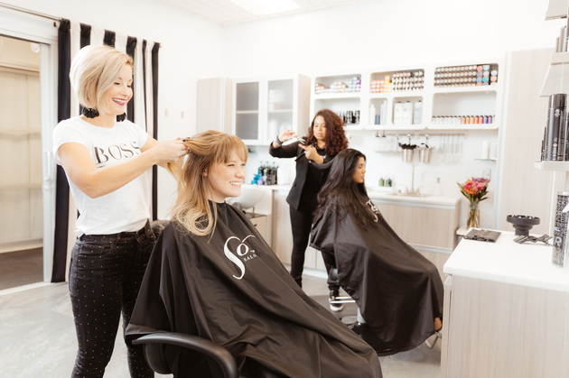 Two stylists working in a double studio