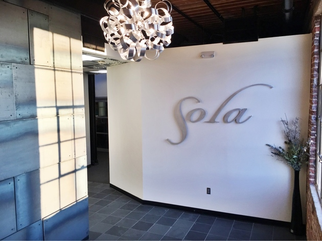 Industrial modern entryway to Sola Salons South End