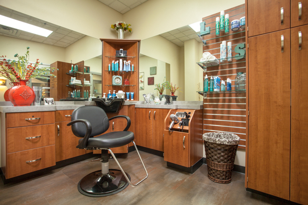 A Sola Salon studio with cabinets, salon chair, and retail shelf located inside Sola Salons in Tacoma, WA.