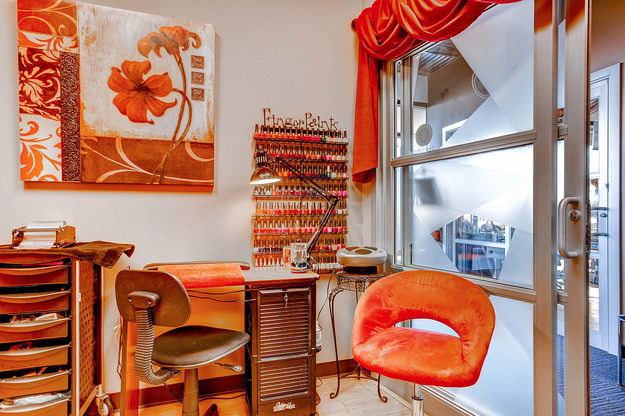 A beautiful nail tech studio in Sola Salon Studios in Littleton, Colorado.