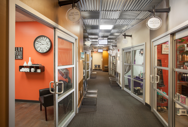 Contemporary Sola hallway with glass sliding door studio entries and business signs above doorways