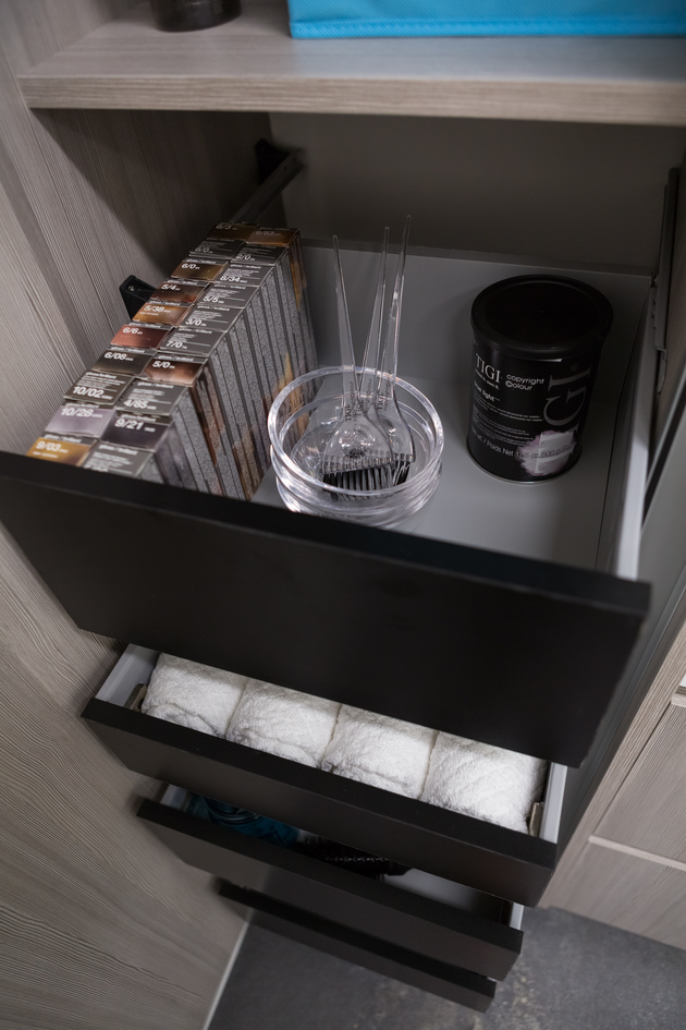 Well organized black studio drawers.