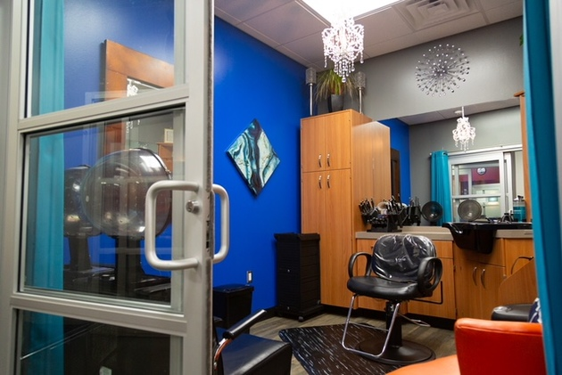 Custom leather sheers holder used by stylist at Sola Salon Studios hair salon in Longview
